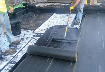 applying adhesive to flat roof